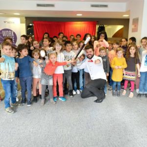 Picture of a group of kids with a magician