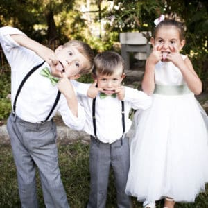 Kids dressed for a wedding party