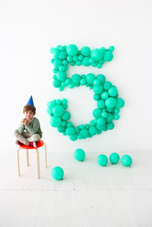 child with giant number 5